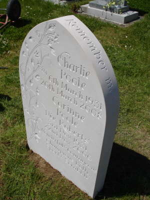 Headstone with lettering on curved edge
